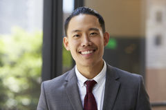 Young Asian businessman looking to camera, close up Royalty Free Stock Photos