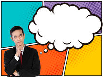 Young Asian businessman looking up to thinking bubble in comical style. Business concept in comical style. Young Asian businessman looking up to thinking bubble Royalty Free Stock Photo