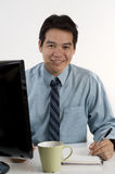 Young Asian businessman at the office Royalty Free Stock Image