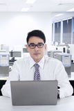 Young asian businessman in office Royalty Free Stock Photos