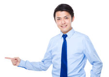 Young asian businessman pointing up Stock Image