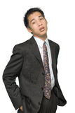 Young Asian businessman portrait. Portrait middle up of a standing young dynamic Asian businessman or executive with a casual attitude of success and defying stock photos