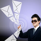 Young Asian businessman sending email Stock Images