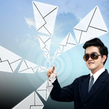 Young Asian businessman sending email Royalty Free Stock Photo