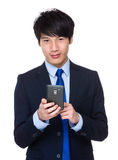Young asian businessman sends a text message Royalty Free Stock Photo