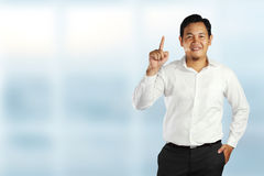 Young Asian Businessman Showing Number One Gesture Stock Photos