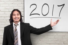 Young asian businessman showing 2017 number Royalty Free Stock Photography