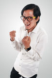 Young Asian Businessman Showing Winning Gesture Royalty Free Stock Photo