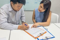Asian businessman signing contract in the office stock photo