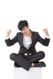Young asian businessman sit and feel freedom Stock Image