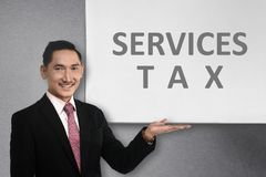 Young asian businessman standing beside whiteboard with service stock image