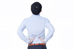 Young Asian businessman suffering back pain - office syndrome concept Stock Image