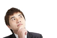 Young asian businessman thinking Royalty Free Stock Photography