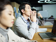 Young asian businessman thinking during meeting Royalty Free Stock Photos