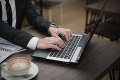 Young Asian businessman working with a laptop Royalty Free Stock Photo