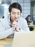 Young asian businessman working in office Stock Image
