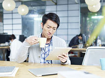 Young asian businessman working in office Stock Photos