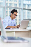 Young asian businessman working in the office. Young asian businessman working  with laptop Royalty Free Stock Image