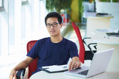 Young asian businessman working in the office. Looking at camera smile Stock Images