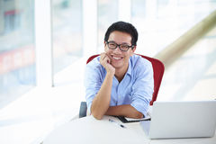 Young asian businessman working in the office. Looking at camera smile Stock Photos