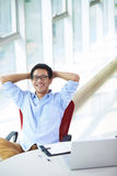 Young asian businessman working in the office. Looking at camera smile Royalty Free Stock Photos