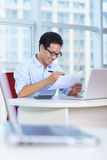 Young asian businessman working in the office. Smile Royalty Free Stock Image