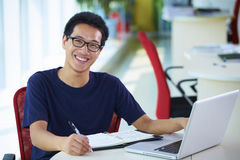 Young asian businessman working in the office. Smile at camera Royalty Free Stock Photography