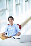 Young asian businessman working in the office. Smile at camera Royalty Free Stock Photos