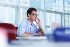 Young asian businessman working in the office. Talking on the phone Royalty Free Stock Image