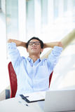 Young asian businessman working in the office. Thinking in the chair Royalty Free Stock Images