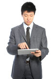 Young Asian businessman working on a PC tablet Stock Image