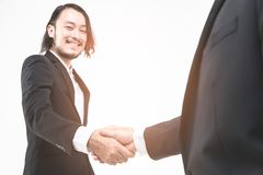 Asian businessmen handshake with some businessman stock photography