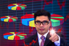 Young Asian businessmen, wearing dark glasses and black suits, pointing fingers pointing graph, Eyes are committed, in the work, stock images