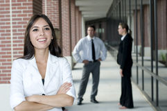 Young asian businesswoman. With her team in the background Royalty Free Stock Photography