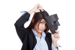 Young Asian businesswoman with a black mask Stock Image