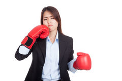 Young Asian businesswoman with boxing glove Stock Images