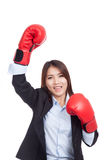 Young Asian businesswoman with boxing glove Royalty Free Stock Photography
