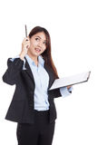 Young Asian businesswoman with clipboard  get an idea Royalty Free Stock Images