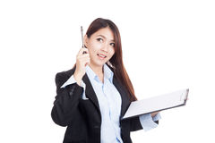 Young Asian businesswoman with clipboard  get an idea Stock Photography