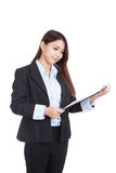 Young Asian businesswoman with clipboard Royalty Free Stock Photo