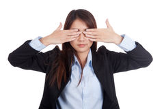 Young Asian businesswoman close her eyes with both  hands Stock Image