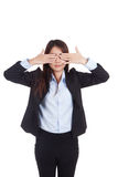 Young Asian businesswoman close her eyes with both  hands Royalty Free Stock Photos