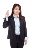 Young Asian businesswoman cross her fingers look away Stock Photography
