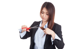 Young Asian businesswoman cut her hair Stock Image