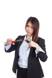 Young Asian businesswoman cut her hair Stock Photo