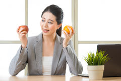 Young asian businesswoman eating healthy snack Stock Photography