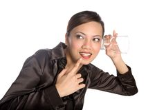 Young Asian businesswoman eavesdropping Stock Photography