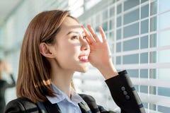 Young asian woman enjoy sunshine. Young asian businesswoman enjoy the sunshine and not afraid of suntan royalty free stock photo