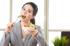 Young asian businesswoman enjoying a healthy salad Royalty Free Stock Photo