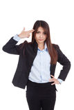 Young Asian businesswoman gesturing a headshot Royalty Free Stock Images